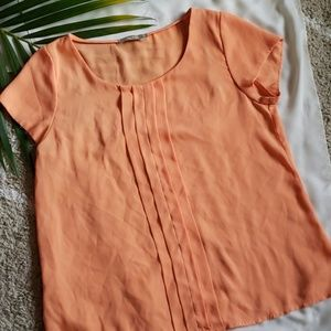 Orange forcast short sleeves top